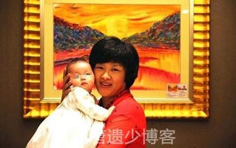 央视女主播李小萌近况,中国最大老虎与央视女主播李小萌