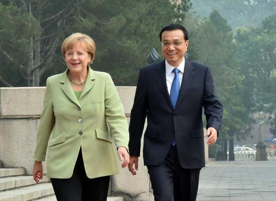德国女总理默克尔简历,德总理默克尔年轻照片